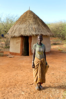 Pokot woman outside her house